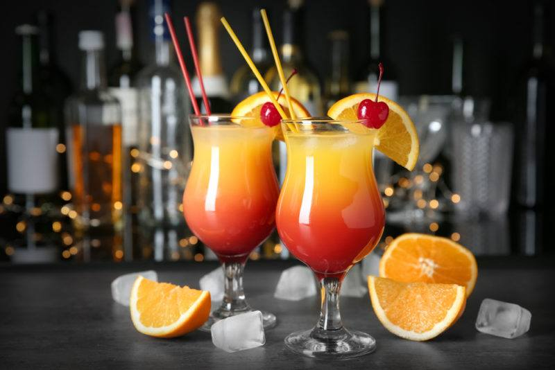 Two sex on the beach cocktails on a bar