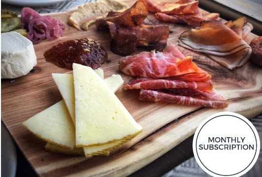 Meat and cheese on a board