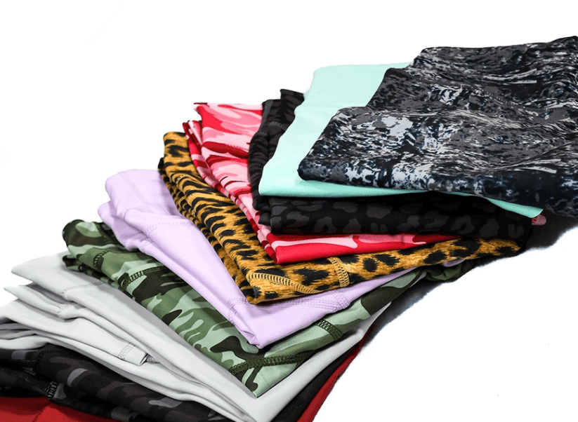 Several pairs of leggings fanned out of various colors and patterns