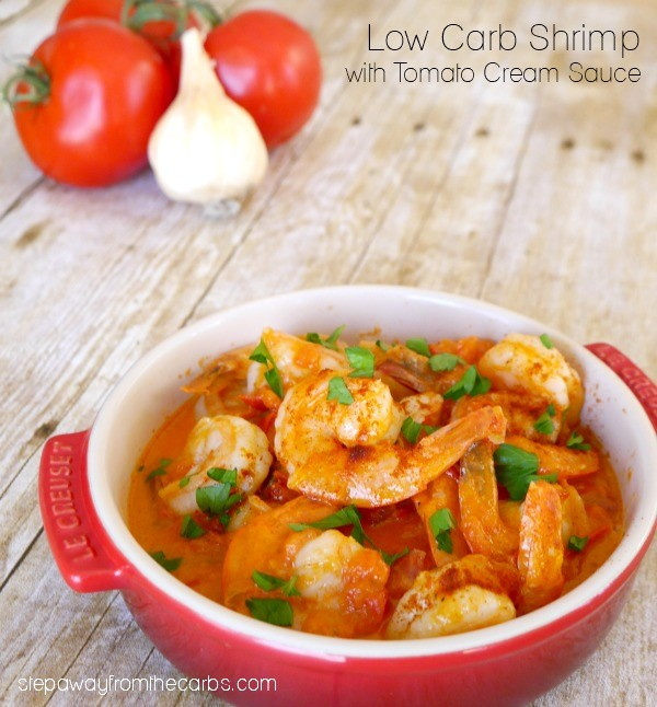 A red bowl with shrimp and sauce