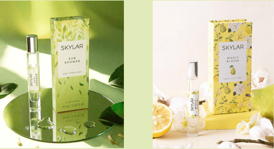 Two photos each with a fragrance box and small spray bottle of perfume. the one on the left has a green background and green box that says sun shower the box and background are decorated with leaves and rain drops.  On the right yellow box with pears and flowers decorating the box that says magic bloom around the box are white orchids and a lemon