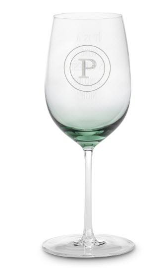 Slightly green wine glass with a P engraved in circles