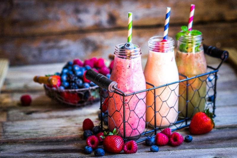 A collection of three smoothies in a wire cage