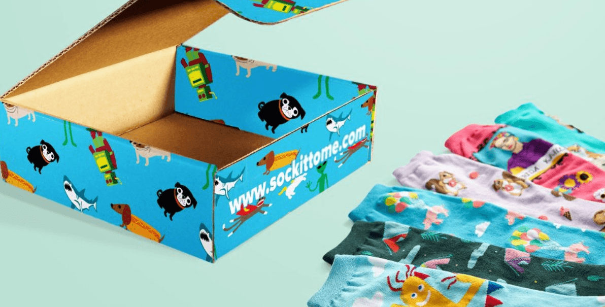 Sock it to me sock box with fun cartoon designs and socks with fun designs