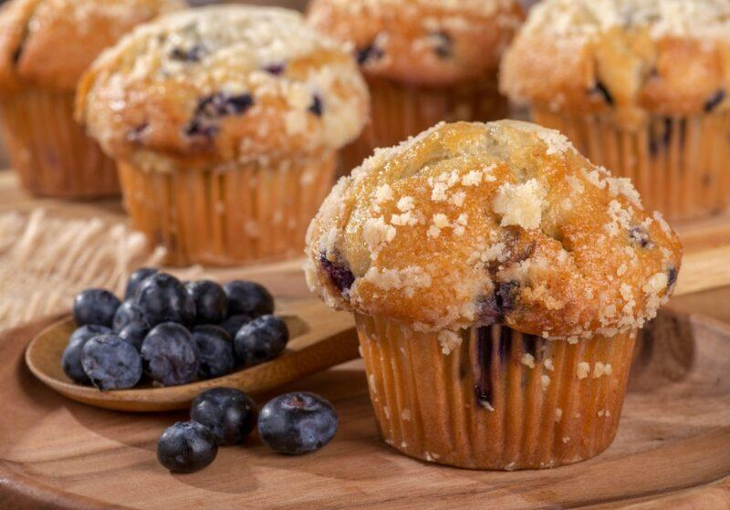 Four types of muffins with fresh blueberries