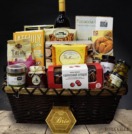 Basket with snacks and wine
