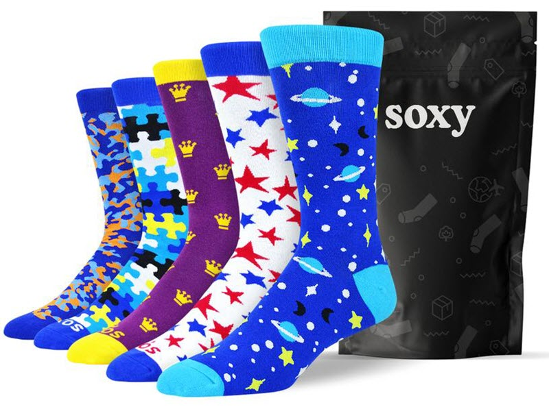 An image from the Soxy Sock site, showing five different brightly colored socks on fot models, next to a black Soxy bag