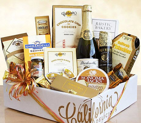 A pretty gift box with wine, chocolate and snacks