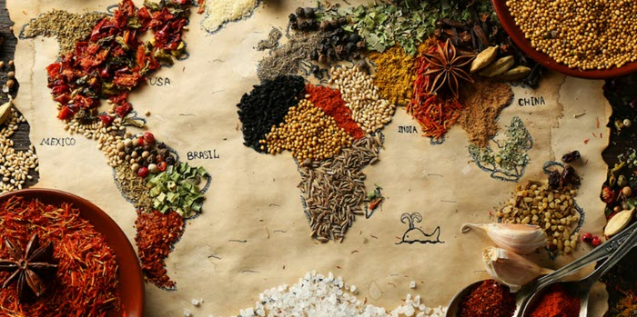 A selection of spices on a world map