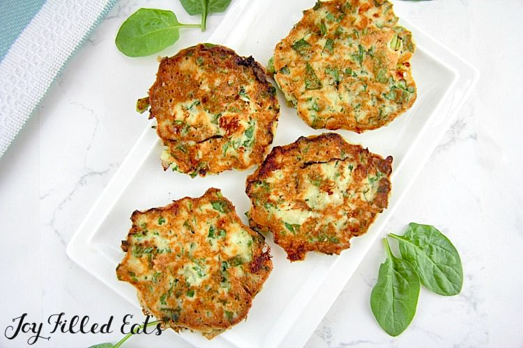 A white plate with spinach and feta pancakes