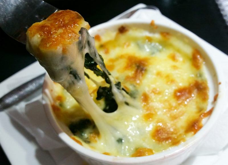 Spinach and cheese served in a ramekin