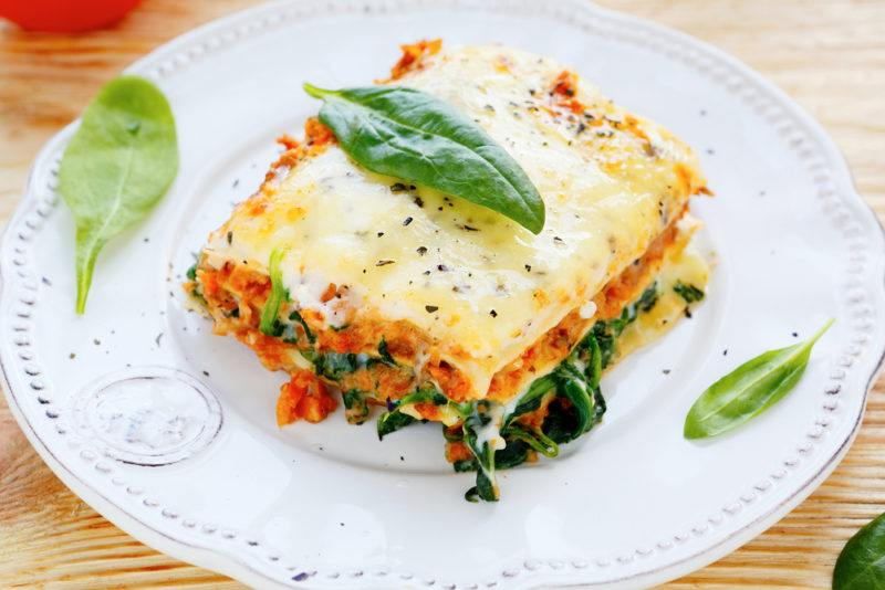 Lasagna that has been made with spinach and meat