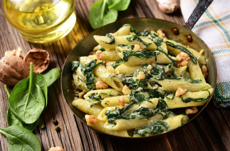 A dish containing spinach and pasta