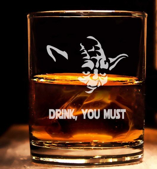 A whiskey glass with Yoda engraved upon it.