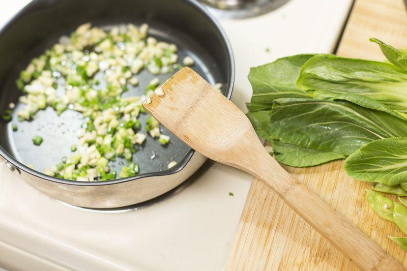 Stir Fry Pan Stove Wooden Spatula Onion Garlic Ginger