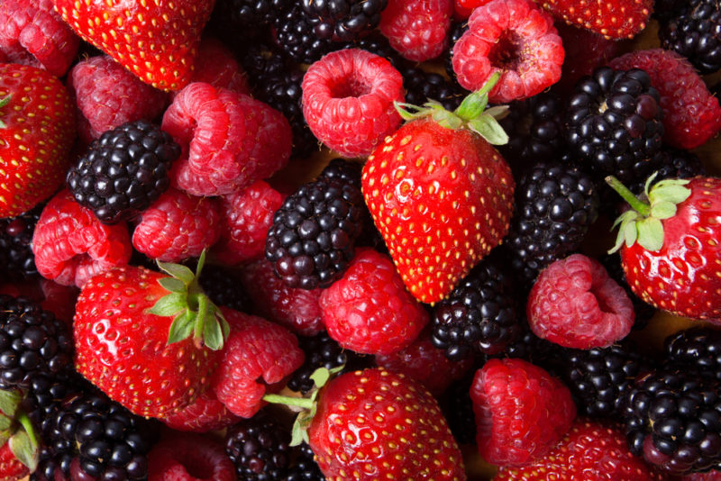 A pile of strawberries, raspberries, and blackberries