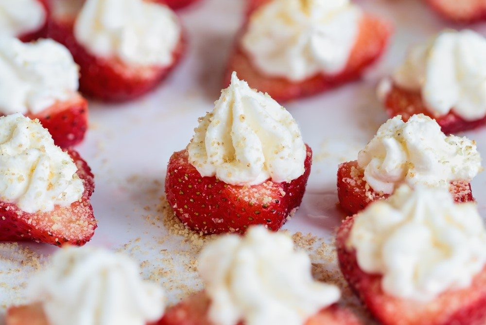 A selection of fresh strawberries with cream cheese topping
