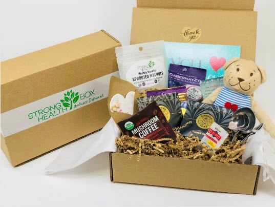 A brown box with snacks and various other products