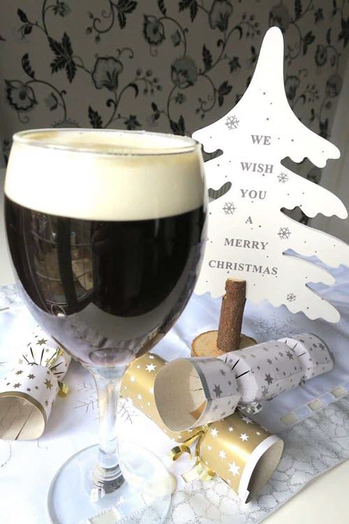A dark cocktail with Christmas symbols