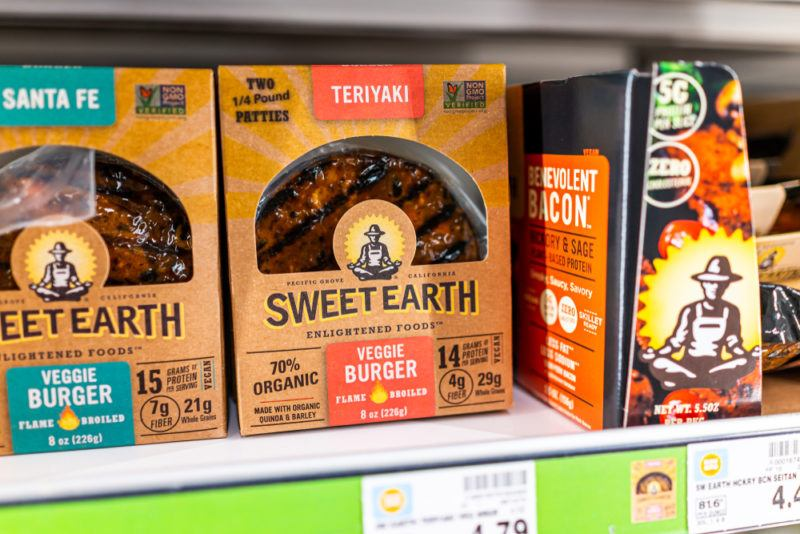 A grocery store shelf showing a few different Sweet Earth vegan products