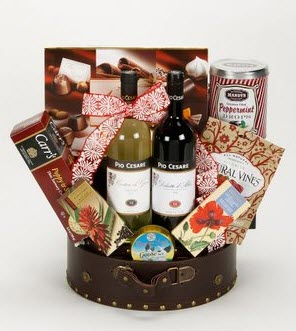 A cake tin filled with snacks and wine