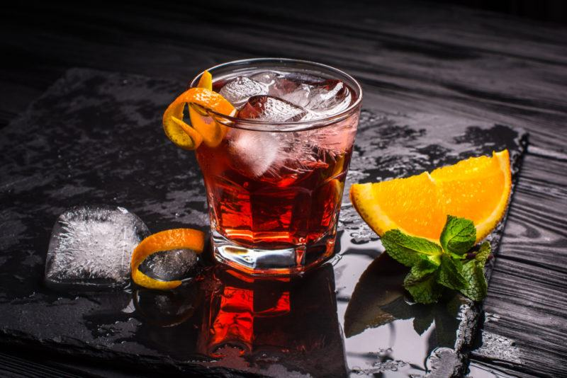 A negroni made using tequila on a black table