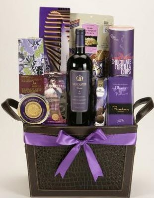 Basket with a purple bow, wine and snacks