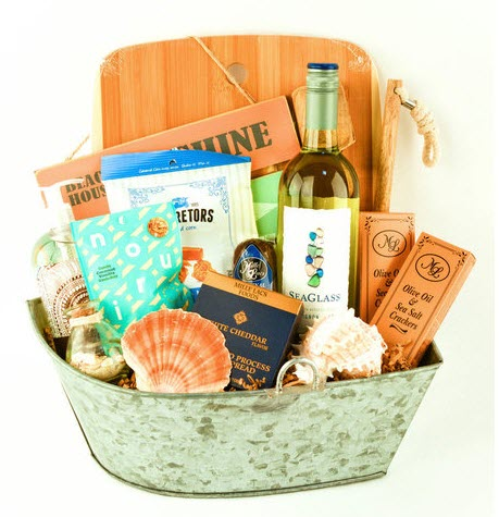 A silver boat basket with various orange-colored items.