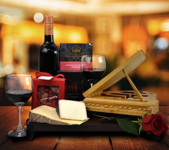 Bottle of wine, cheese and a small piano