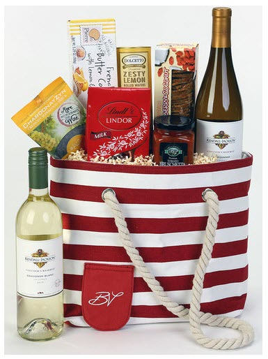 A beach bag filled with wine and snacks