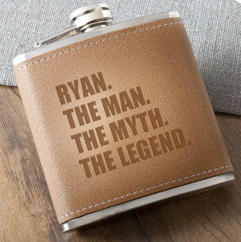 A brown flask that says 'the man, the myth, the legend'