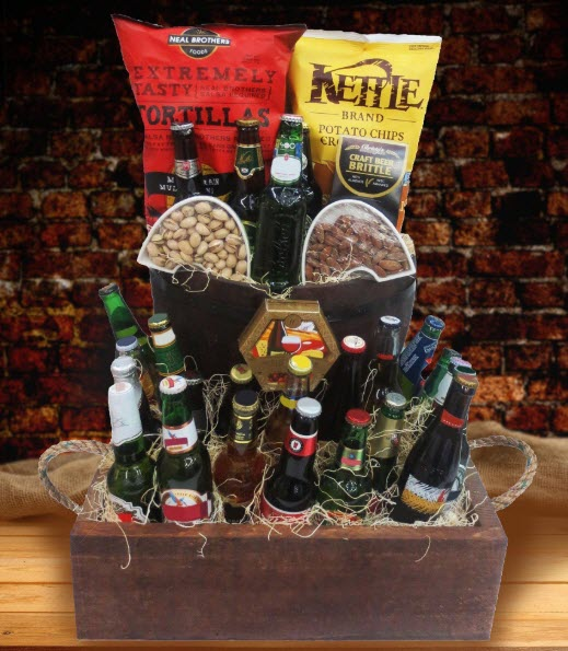 Large wooden box filled with straw, beer and snacks.