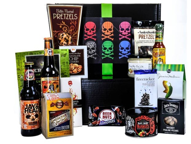 A selection of beer and snacks, along with a black box, prominently featuring skulls.