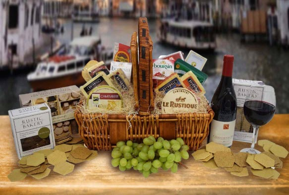 Basket that contains a large selection of cheese against a pretty background.