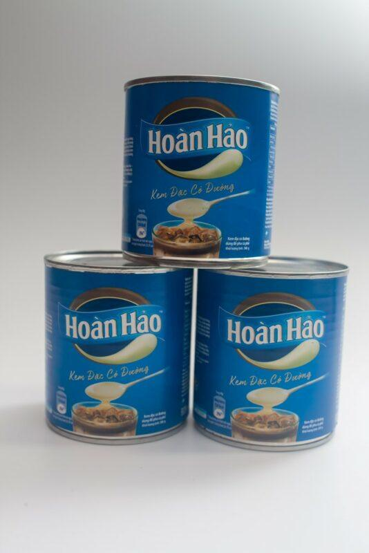 Three cans of condensed milk that are used in Vietnam for coffee and other drinks