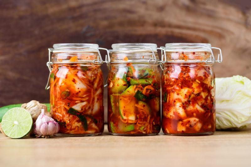 Jars of radish kimchi, cabbage and cucumber