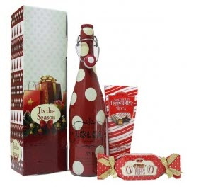 Red spotted wine bottle with treats