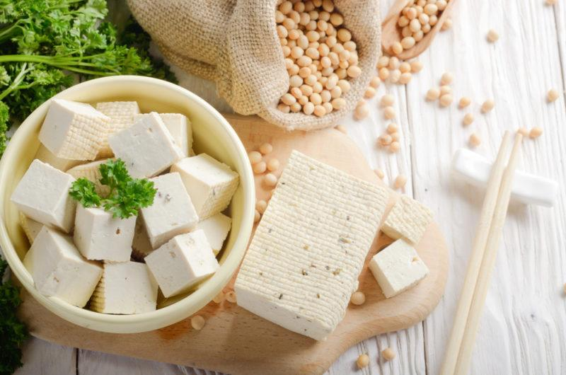 Cubed tofu, with a piece of tofu and soybeans