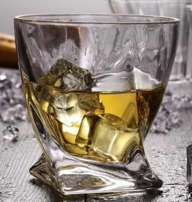A whiskey glass that seems to have been twisted