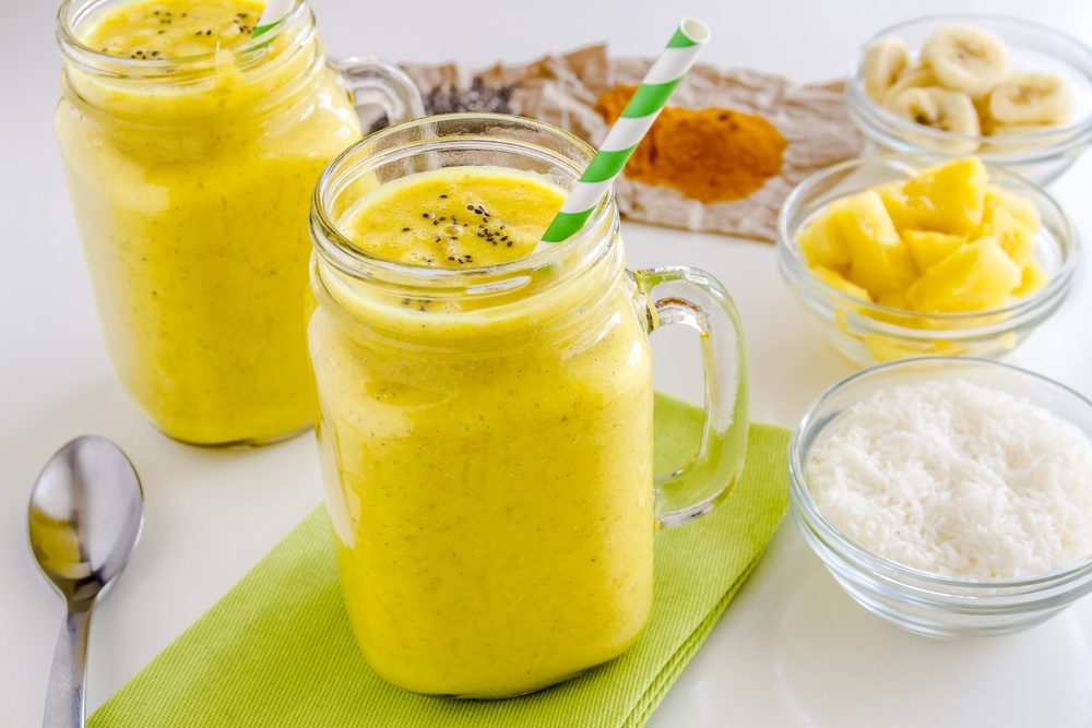 Two turmeric smoothies with various spices