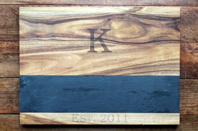 Wooden cutting board with a monogram and slate tray