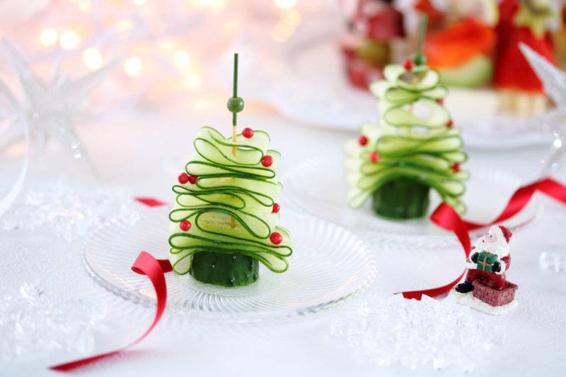 Two Christmas trees made out of sliced cucumber