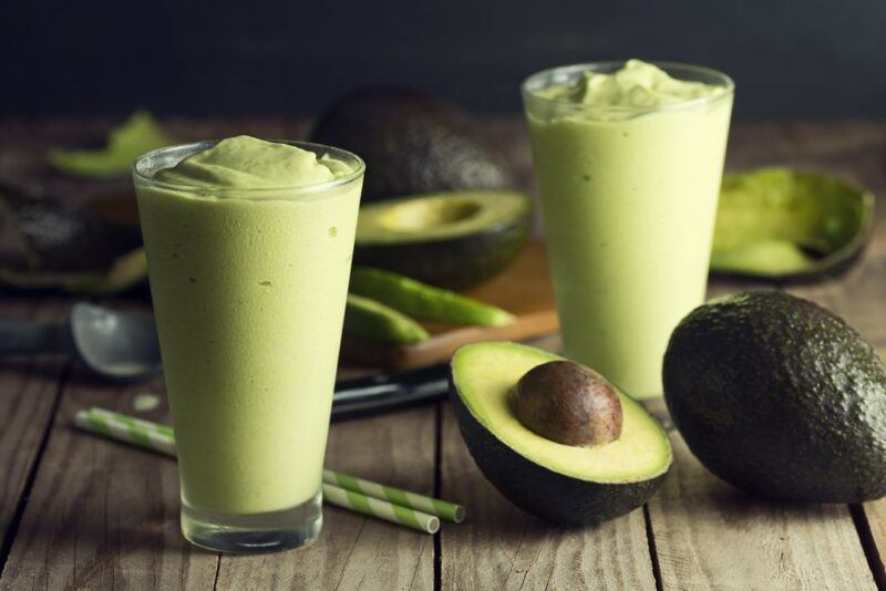 Two glasses of an avocado smoothie