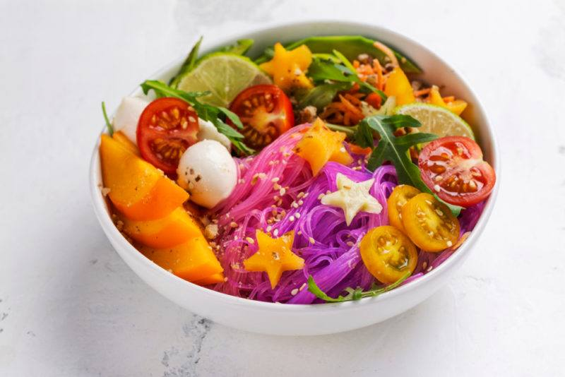 A white bowl with colored ingredients, including stars