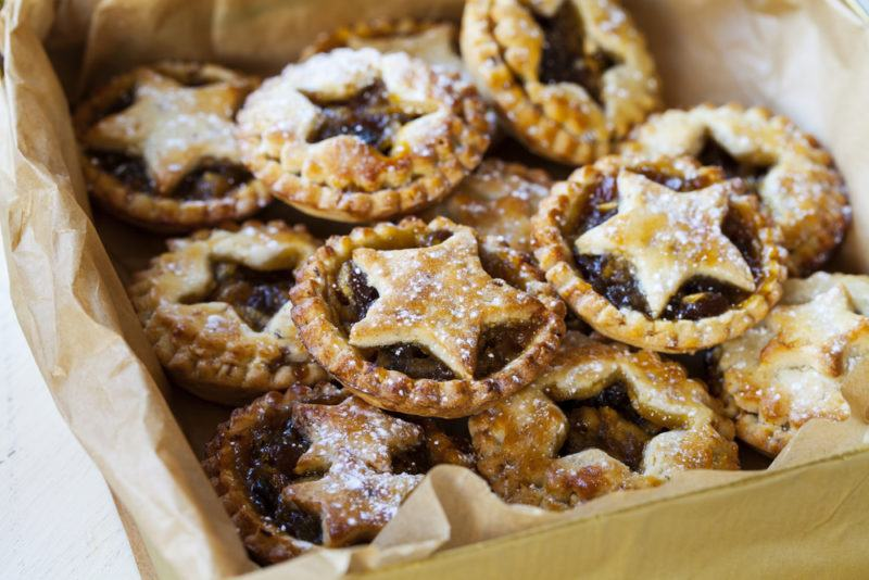 A selection of small Christmas mince pies with stars in a box