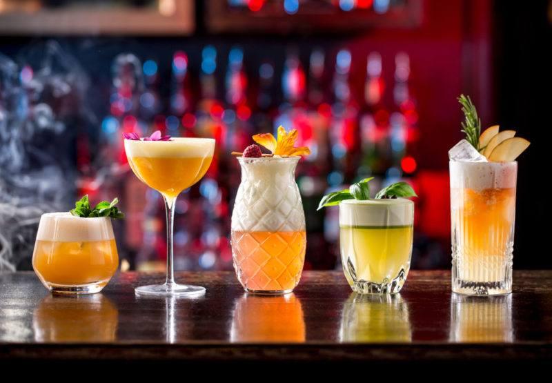 Variou cocktail fizzes on a bar