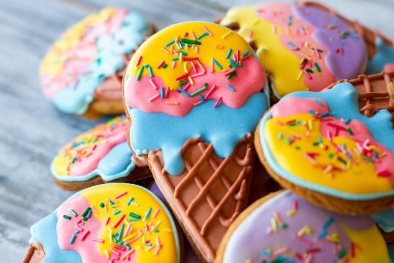 Iced cookies in the shape of ice cream cones with colored icing