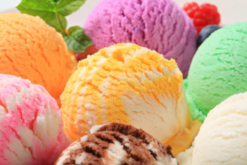 A selection of ice cream scoops of various colors