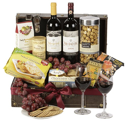 A suitcase that contains wine, crackers and cookies.