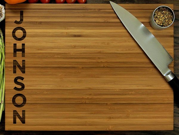 A cutting board with the name Johnson engraved on one side.